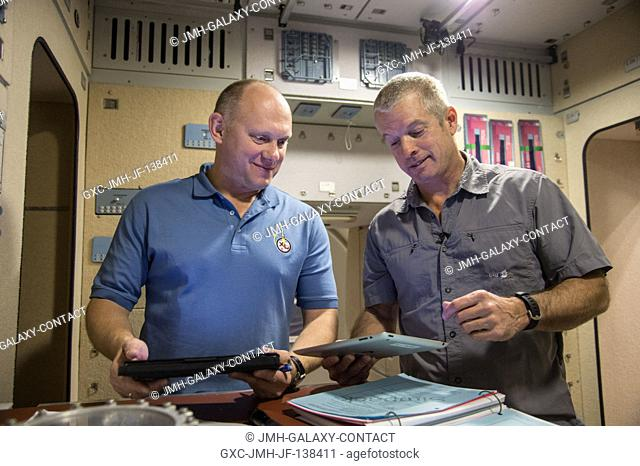 NASA astronaut Steve Swanson (right), Expedition 39 flight engineer and Expedition 40 commander; and Russian cosmonaut Oleg Artemyev