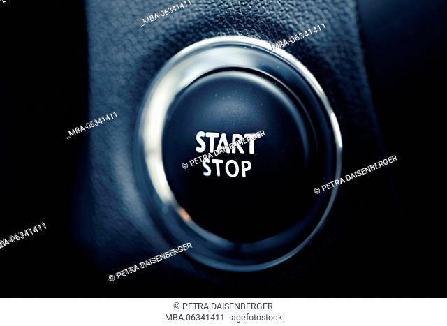 The start stop button of a car. Symbol for Begin and end, drive, engine and beginning