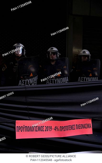 """Police forces in front of Ministry of Economy in Athens, lettering """"""""Budget 2019 4% surplus"""""""". 22.11.2018 