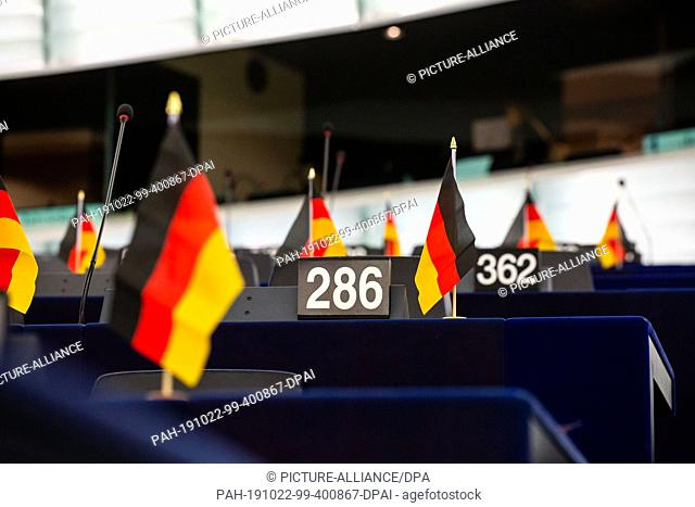 22 October 2019, France (France), Straßburg: Small German flags stand on the tables of members of the ID Group in the plenary hall of the European Parliament