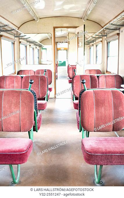 Old fashioned train interior showing empty seats