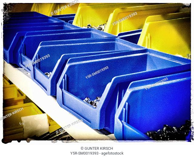 Blue and yellow boxes in a rack