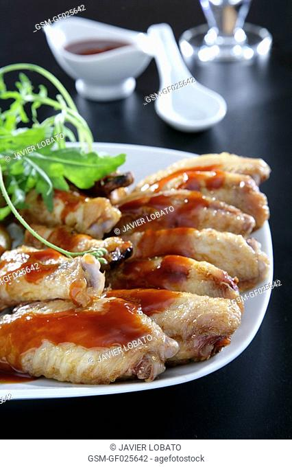 Chicken wings with roast potatoes and barbecue sauce