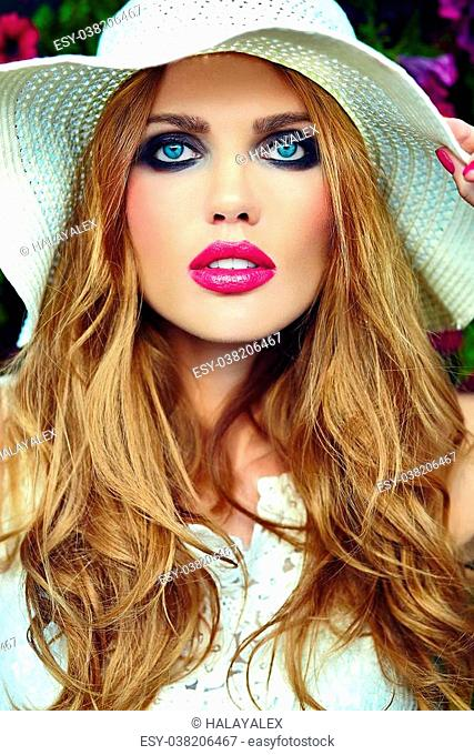 High fashion look.glamor closeup portrait of beautiful sexy stylish blond young woman model with bright makeup and pink lips with perfect clean skin in hat near...