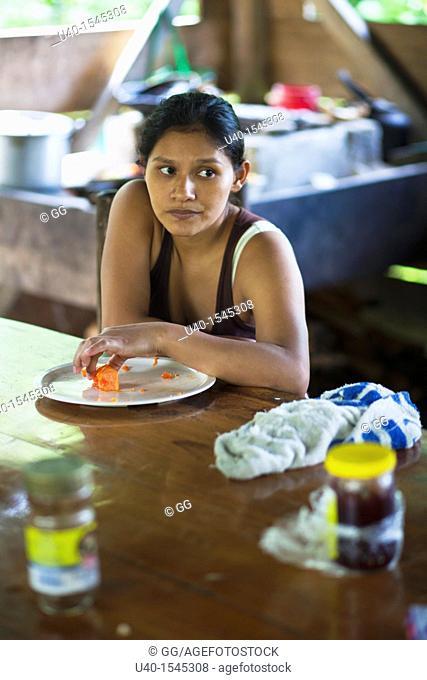 Guatemala, Rio Dulce, woman in kitchen