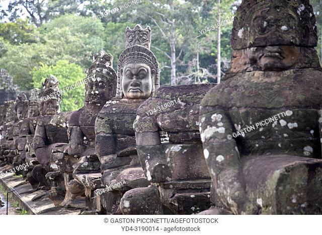 Detail of the stone faces on the bridge at the south gate of Angkor Thom, Angkor Temples complex, Siem Reap Province, Cambodia, Asia. .