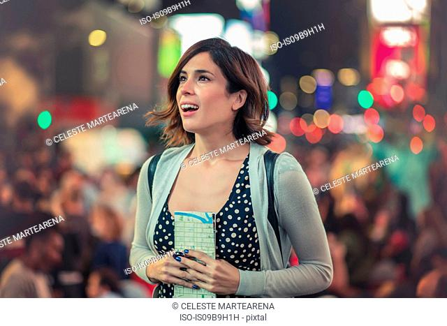 Portrait of woman in Times Square looking away in awe, New York, United States, North America