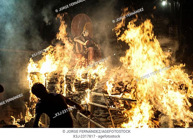 Holika's death signifies the triumph of good over evil. Holika is associated with the annual bonfire on the night before Holi, Uttar Pradesh, India, Asia