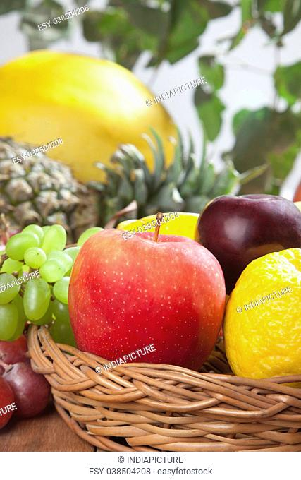 Wicker basket filled with fresh fruits
