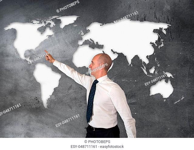 a Businessman pointing a point on the world map