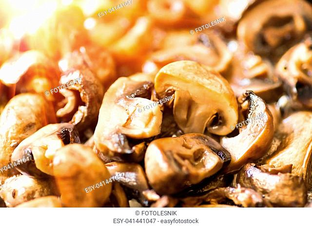 Fried in a frying pan, mushrooms, champignons, closeup background