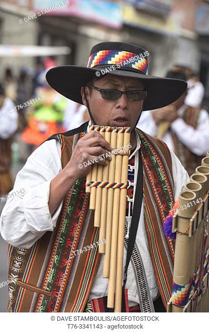 Kollasuyo man playing a siku (panpipe) at the Gran Poder Festival, La Paz, Bolivia