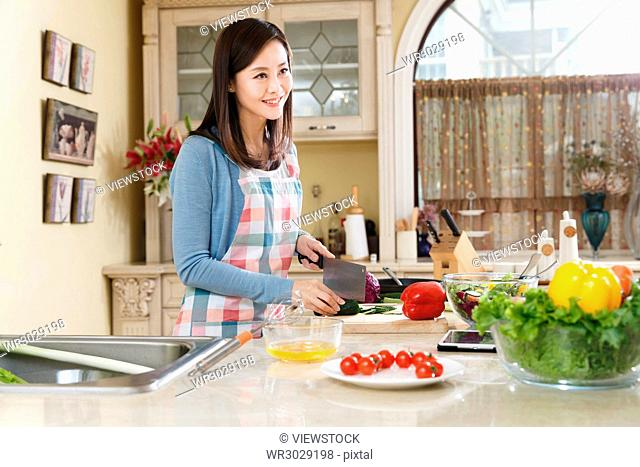 A woman in the kitchen
