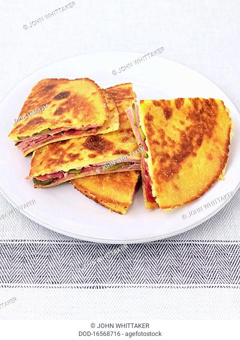Quesadilla with ham, gherkin, and smoked cheese