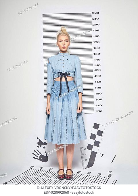 Young girl in beautiful blue dress mows opposite jail line up