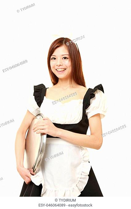 portrait of young Japanese woman wearing french maid costume