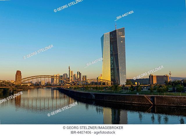 European Central Bank at sunrise, in front of Frankfurt skyline, Frankfurt, Hesse, Germany