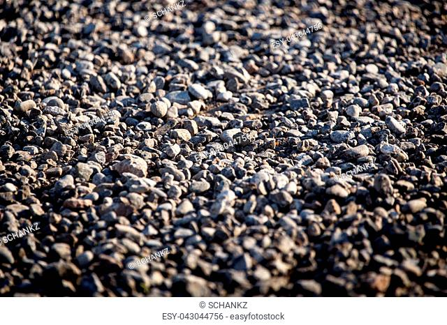 Crushed stone on the road as a background