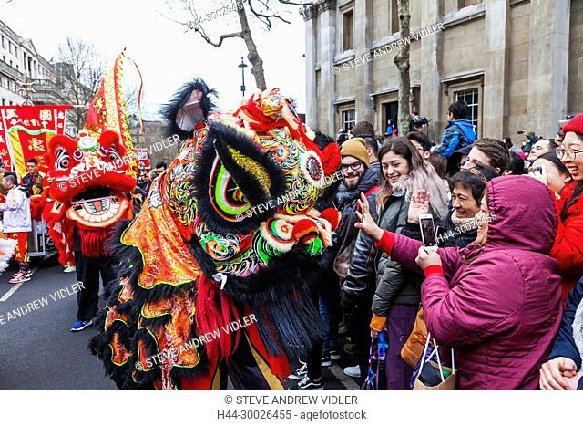 England, London, Chinese New Year Parade, Child Wearing Chinese Lion Mask