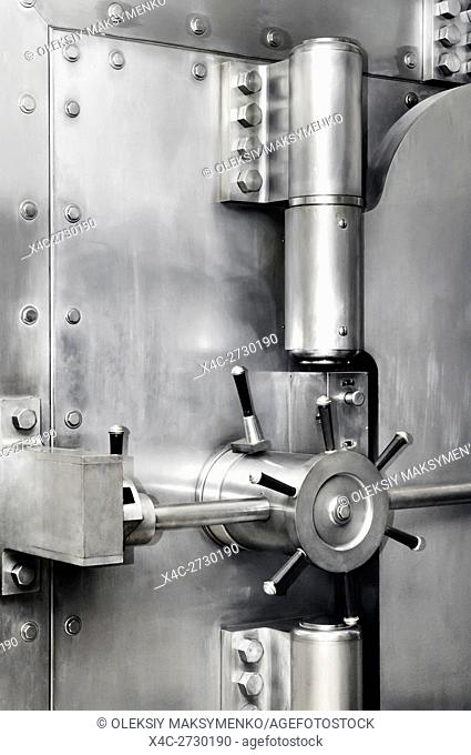 Bank vault stainless steel safe door lock and hinges. Banking, safety deposit, security concept