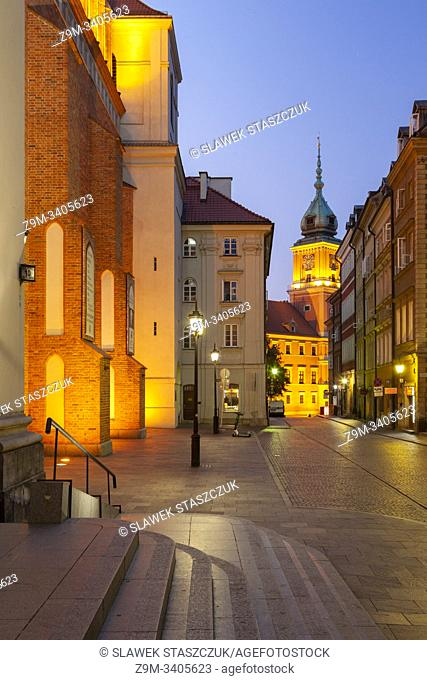Dawn in Warsaw old town, Poland. Royal Castle tower in hte distance