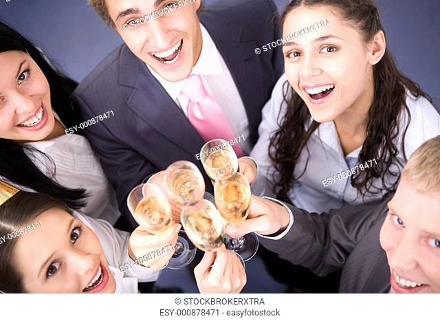 Photo of happy friends cheering up during corporate party
