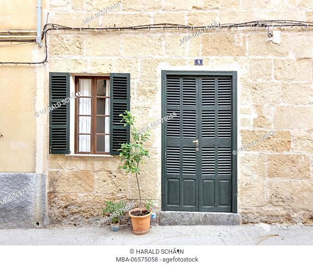 Spain, Majorca, Alcúdia, facade, house, number 4, door, window, shutters, potted plants, pedestrian area