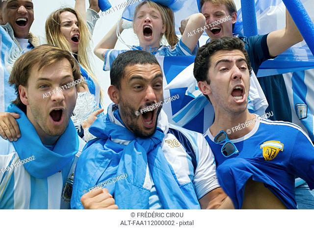 Argentinian football fans shouting in victory at match