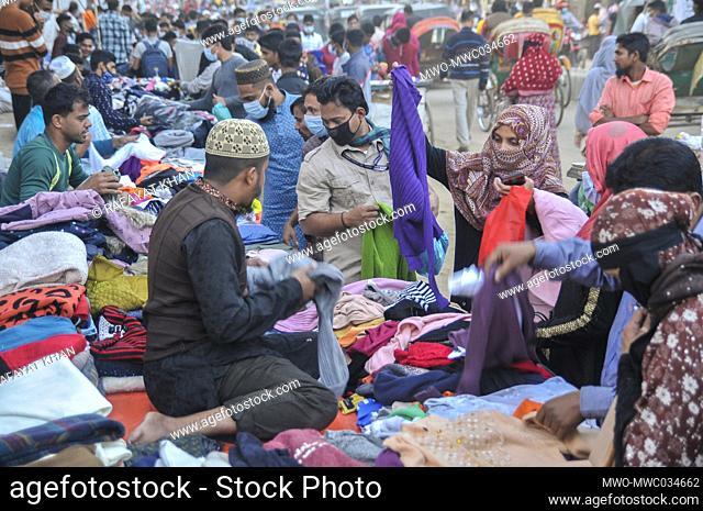 Customers are busy buying winter clothes at street shops in Sylhet, Bangladesh