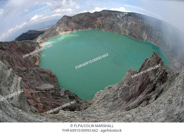 Turquoise-green coloured acid volcanic crater lake, with steam rising, Mount Ijen, East Java, Indonesia