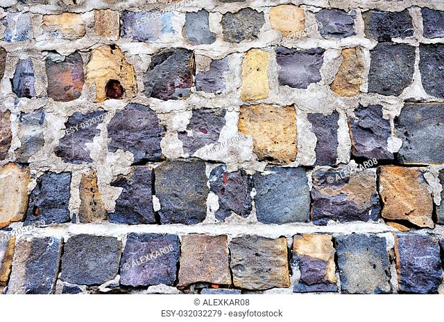 Broken antique old stone wall retro background