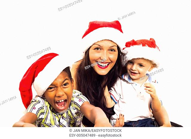 Funny children and woman celebrating Christmas, isolated on white background