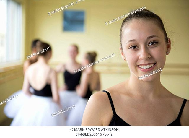 Portrait of girl smiling in ballet studio
