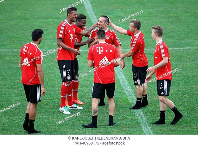 Player of FC Bayern Munich joke with Franck Ribery (C) after the training in Arco, Italy, 10 July 2013. From 04 July to 12 July 2013 the Bundesliga soccer team...