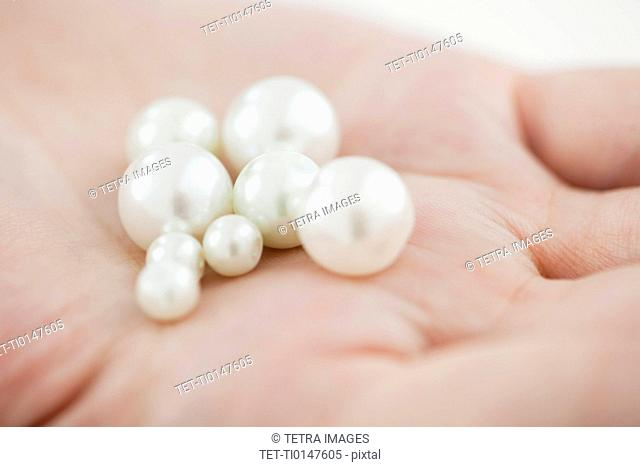 Woman holding pearl