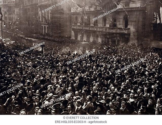 Celebrating American crowd on Peace Monday, Nov. 11, 1918. New Yorkers gathered at Broad and Wall Streets in the Financial District