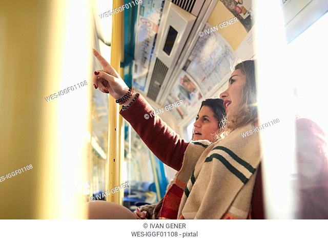 UK, London, two women in underground train checking the connection