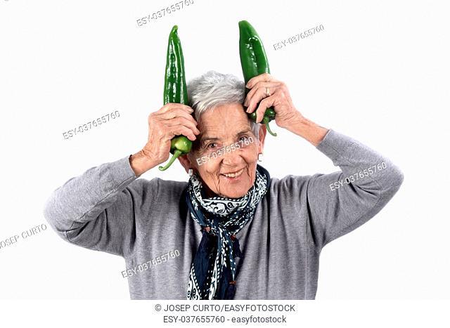 senior woman eating pepper on white