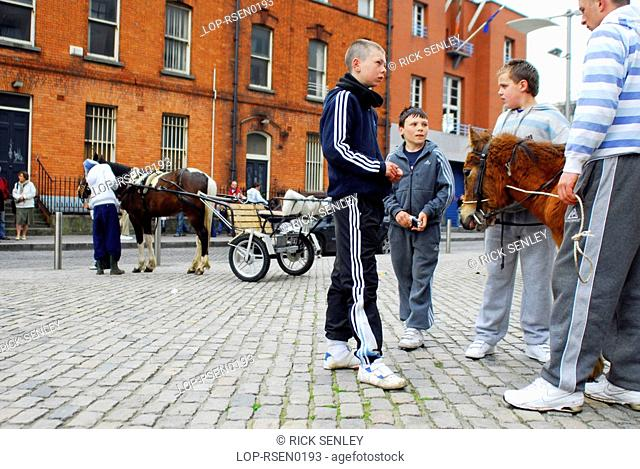 Republic of Ireland, Dublin, Smithfield Horse Market, Youngsters with the horses at Smithfield Horse Market in Dublin