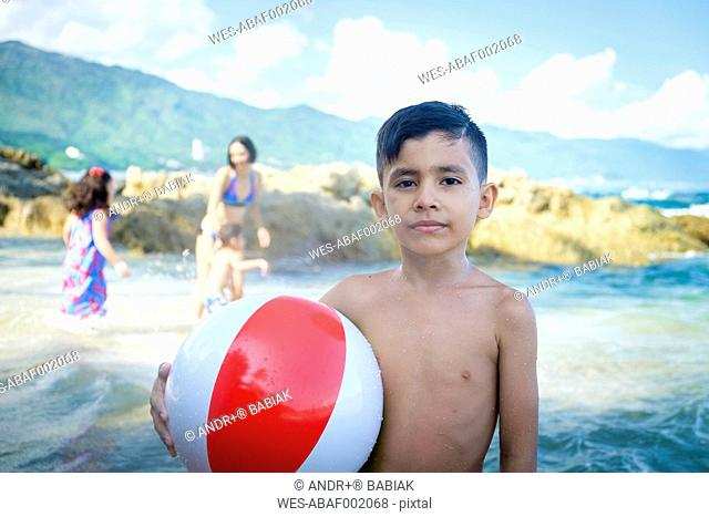 Portrait of boy with beach ball