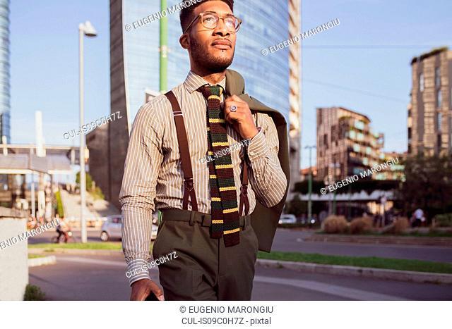 Businessman walking in city, Milano, Lombardia, Italy