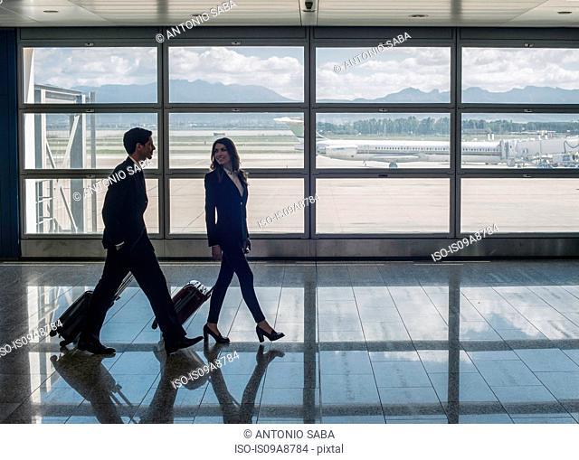Businesspeople walking in airport