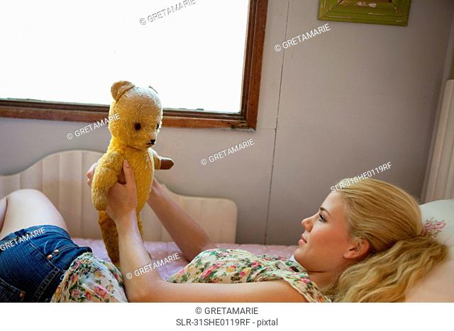 Girl speaking with teddy