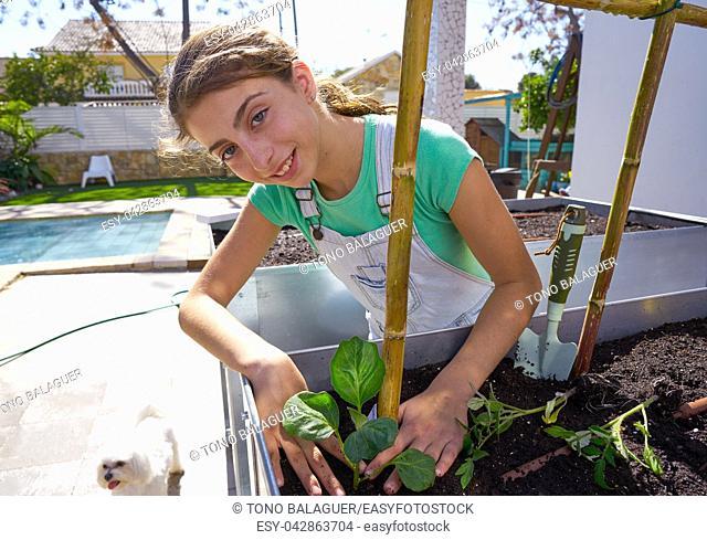 Girl working in orchard raised bed urban garden