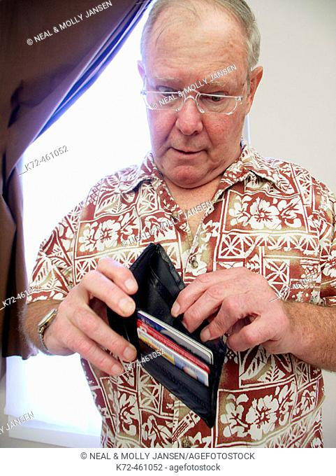 Surprised Older Man Looking Into Empty Wallet