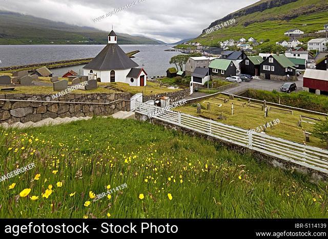 The small village Haldarsvik with the octagonal church and view of the Atlantic Ocean, Streymoy, Faroe Islands, Føroyar, Denmark, Europe