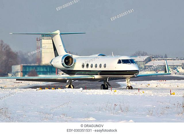 Business jet taxiing to the runway in winter