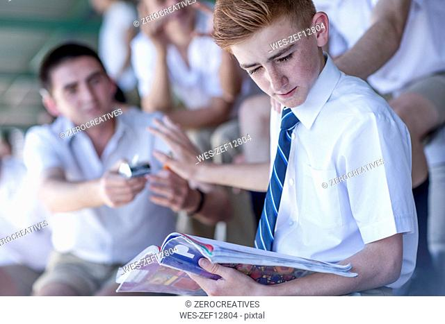 High school student denying to take a cigarette from classmate