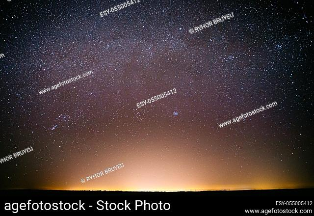Real Night Sky Stars Background With Natural Colourful Sky Gradient. Sunset, Sunrise Light And Starry Sky. Yellow And Blue Colors Over Horizon