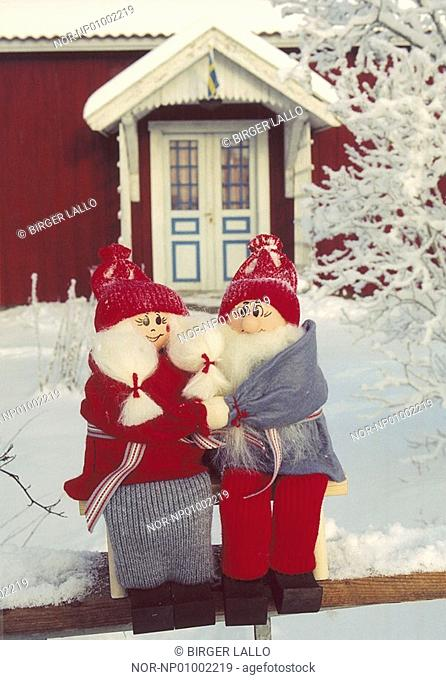 Close-up of two elves in front of a house